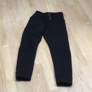 Black Ivivva sweat pants.